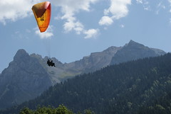 up high touch the sky (eeeelle) Tags: boy sky france alps sunny paragliding touchthesky