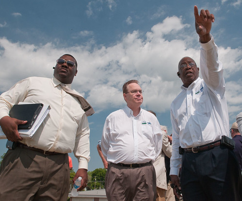 U.S. Department of Agriculture Louisiana State Director Clarence W. Hawkins (right) explains to Undersecretary for Rural Development Dallas Tonsager (center), various aspects of the Mississippi River flooding in front of the levee they stand on in Vidalia, LA, on Thursday, May 19, 2011. Supporting the event production was Assistant to State Director Lee Jones (left). USDA Photo by Lance Cheung.