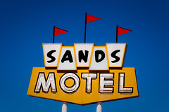 Sands Motel - Route 66 (TooMuchFire) Tags: blue sky signs newmexico route66 flags sands grants motels lightroom oldsigns motherroad vintagesigns oldmotels canon30d sandsmotel motelsigns vintagemotels route66signs newmexicoroute66 toomuchfire newmexicosigns 112mcarthurstgrantsnm