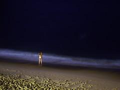 Contemplation Over Blue   Contemplando o azul (Andre Carregal) Tags: blue light sea white luz praia water girl rio gua azul riodejaneiro night standing mar still sand long exposure shadows natural areia over noturna foam noite garota vermelha parado em p sombras urca branca sobre contemplation espuma meditao