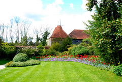 A Sideways View of a Part of Great Dixter (antonychammond) Tags: uk flowers trees england green gardens britain lawn picturesque eastsussex christopherlloyd oasthouse greatdixter bej beautifulexpression abigfave firsttheearth citrit theperfectphotographer goldstaraward winnr