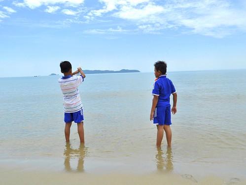 Kids, ocean and sky