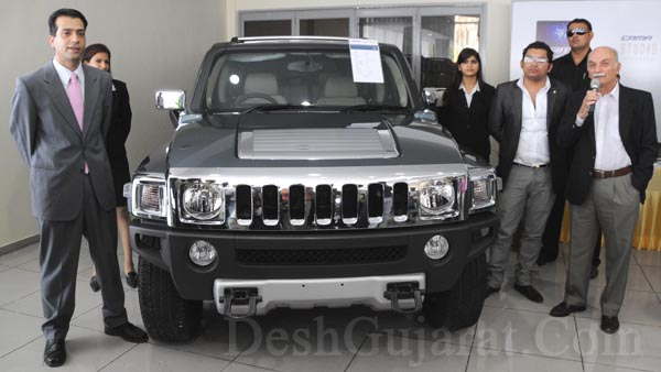 Ruston Cama, Jehangir Cama and others at Ahmedabads Cama Motors show-room standing with a Hummer car, which has been brought for the first time in Gujarat