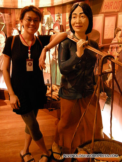 Rachel posing with a street vendor statue