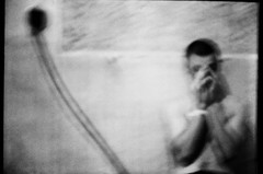 (tataata) Tags: longexposure summer people bw blur film boys hands grain zenit 2009 antiphoto lowfi helios442