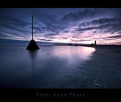 Embrace the beauty (Ptur Gunn Photograpphy) Tags: blue sunset sea lighthouse black reflection beach beauty night photo iceland long exposure purple angle 10 sony tripod great wide sigma super alfa mm 20 700 1020 sland petur gunn ptur gunnarsson viti grtta abigfave emrace ocien