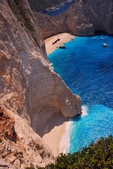 Navagio - Shipwreck (Stefano Mazzoni) Tags: blue wedding sunset sea party summer vacation bw white holiday black hot nature beauty contrast island boat holga nice nikon rocks barca tramonto mare waves estate photos blu infinity toycamera picture bn greece shipwreck filter grecia enjoy splash roccia infinito bianco nero infinite vacanza zante laganas zakynthos onde caldo ionian d60 marmo shipwreckbeach contrasto nolimits robinsoncrusoe immensity granito navagio danieldefoe nikond60 spiaggiadelrelitto stefanomazzoni immenso concordians navagiobeach zakyinthos naturemare vacanzevacation