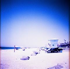 Carlsbad Beach (The Dalai Lomo) Tags: carlsbad carlsbadbeach beach random lifeguardtower agfactprecisa100 agfactprecisa100fordianamini dianamini agafa crossprocessed xpro slidefilm 35mmfilm sandiego