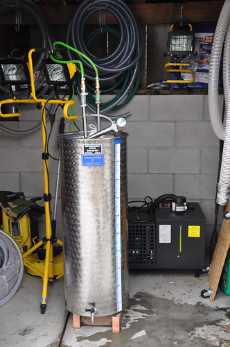 Heres the whole set up. The tank with the wine is on the left, the chiller is the black box on the right. The green stuff is the glycol running through the tubes and into the enclosed plate.