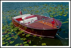 17' Sportsman (Lil Wally) Tags: wood red white lake water boat wooden flag lakeland mahogany lillypads chriscraft