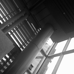 An iPhone photo: Pillar (Dominique James) Tags: city windows light people urban blackandwhite white newyork building tower art texture window lines silhouette metal wall skyline sepia architecture modern skyscraper buildings landscape photography design lomography industrial pattern moody cityscape crossing image pavement top manhattan interior picture dramatic engineering style pedestrian monotone structure slats intersection brooding block backlit shape streetcorner avenue decor parallel atmospheric divide corners iphone wormseyeview glasswall glasspanes iphoneography compartamentalize