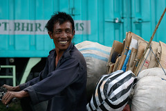 Hard working, yet smiling man in Kupang, Indonesia. (cookiesound) Tags: life trip travel blue summer vacation portrait people holiday man men travelling smile contrast work canon indonesia happy photography reisen asia asien colours fotografie expression urlaub cyan canoneos20d motorbike motorcycle timor canoneos poeple reise travelphotography kupang traveldiary travelphotos smilingman travellingasia reisefotografie travelshots reisefotos reisetagebuch reisebericht travellifestyle cookiesound nisamaier ulrikemaier poepleworking lifeinindonesia poepleintimor travellingindonesia