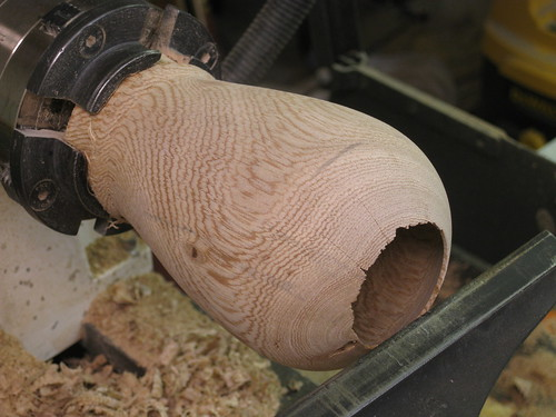 hollow form with ragged edge to lip