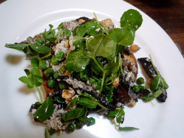 Mushrooms and peas with hazelnut, ricotta and thyme salad on toast