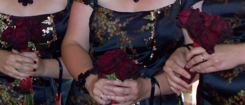Bridesmades with baccara roses