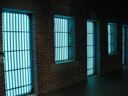 Neon jail cells.