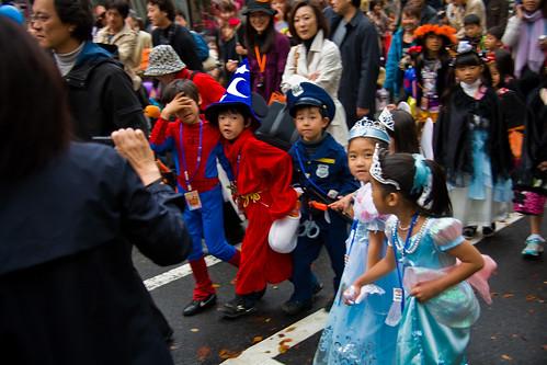 Spiderman, Policeman, Sorcerer's Apprentice, Omotesando Ave, Tokyo by Buz Carter.
