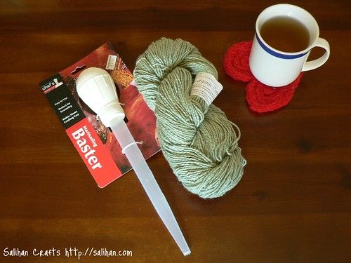 Winding yarn with a turkey baster (materials)