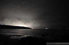The Mystic Beach (recaptured) Tags: sea sky beach water night clouds blackwhite interestingness nikon tokina desaturated arabian ultrawide f28 ultrawideangle d90 magicdonkey explored 1116mm lpcalm