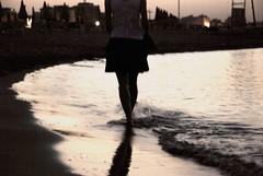 Una camminata indefinita (scarpace87) Tags: sunset sea woman beach girl silhouette donna girlfriend tramonto mare walk rimini definition spiaggia ragazza definizione camminata rivabella