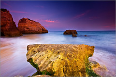 The Beach - Sunset at Praia da Rocha (andrewwdavies) Tags: ocean longexposure travel sunset red sea sky bw holiday motion blur praia beach portugal water geotagged 1 sand rocks tripod cliffs atlantic explore caves lee nd colourful algarve filters grad onsale monolith frontpage hitech picks cpl graduated iberia sentinels eroded rushing praiadarocha portugese circularpolariser canonefs1022mmf3545usm portimao interestingnesspage neutraldensity explored canoneos40d kaesemann andrewwilliamdavies geo:lat=37116958 geo:lon=8545161 gettyartistpicksaugsep091
