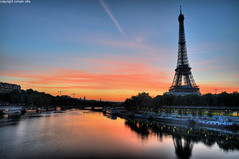 paris (romvi) Tags: paris france reflection tower monument water station seine architecture sunrise river de boats la soleil nikon eau europe tour metro eiffel bateaux villa reflets romain quai hdr bir rer fleuve birhakeim lev d90 rerc peniches hakeim romainvilla romvi