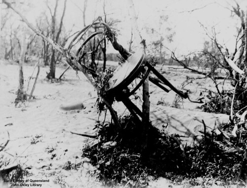 Chair caught in flood debris at Blackall, Queensland, 1906 by State Library of Queensland, Australia