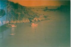 The Creek (jasminfish) Tags: bridge brazil cats colors brasil boats island lomo lomography barcos mask ponte es ilha wrecked máscara vilavelha colorido lomografia gambiarra 3ponte experiência morrodomoreno redscale fujisuperiaiso100 praiadoribeiro muitascores holga135bc