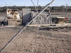 Razor Wire, no. 5 (GC_Dean) Tags: street arizona phoenix train fence space razorwire lateafternoonlight tankcars 52weeks sociallandscape
