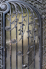 The wrought iron door (jmvnoos in Paris) Tags: door paris france glass lines grid 50mm nikon iron doors curves wroughtiron line 100views 400views 300views 200views porte grille 500views curve fr grids 800views 600views 700views lignes fer grilles ligne verre 1000views portes d300 courbe courbes 75016 2000views ferforg 900views 5faves 10faves 20faves jmvnoos 10favesext 5favesext afsnikkorf14g