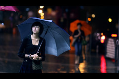 Romance in the Rain (James Yeung) Tags: street girl beautiful rain night umbrella hongkong pretty candid romance rainy romantic streetphoto alantam explored ef135mmf2l romanceintherain canon5dmarkii