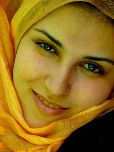 A beautiful Iranian woman in yellow dress