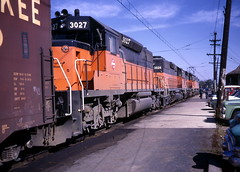 Milwaukee Road, Deer Lodge, Montana (R R Horne) Tags: orange montana lodge deer milwaukee railroads milwaukeeroad