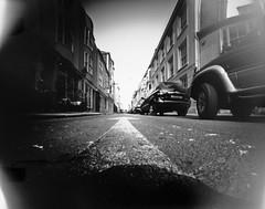 High Street (mr ig) Tags: road camera cars pinhole parked arrow hastings oldtown highstreet eastsussex markings qualitystreettin ikg:filename=20110403pin0019posjpg getoutoftheroadyoufool