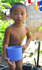 ang tabo bow! (Armand Tingle) Tags: boy cute kid candid philippines nephew bathing je funnyexpression nikond90 filipinochild johnerrol