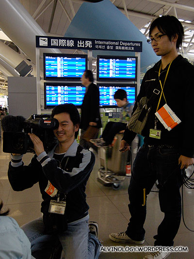 Camera crew going around interviewing the couples in the airport