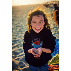 Cory at the Beach (isayx3) Tags: california portrait beach colors girl backlight 35mm hair sand nikon child natural crab wideangle towel cousin nikkor f18 mole huntingtonbeach d3 sandcrab molecrab plainjoe isayx3