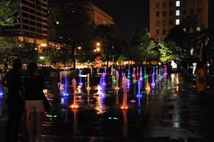 g01 (Ron,Ron,Ron) Tags: wet water fountain reflections downtown nightshot stlouis missouri coloredlights saintlouis 2009 citygarden jun09 nikond90 manmadewaterfeature