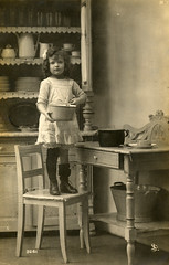 Child in the kitchen (lovedaylemon) Tags: madrid kitchen vintage found child image postcard 1917
