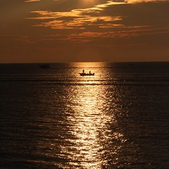 Fishing (kevin dooley) Tags: light sunset orange cloud sun lake fish reflection water ecology silhouette yellow mi gold boat fishing fisherman earth michigan quality salmon environmental sigma sandwich pole reflected health planet perch environment troll trout sustainability ecological newbuffalo 105mm fisheries coho f180 aplusphoto deplete