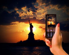 Just calling to say.... (Neelofar_USA) Tags: sunset sky usa newyork water colors beautiful clouds liberty island freedom cloudy telephone statueofliberty ellisisland