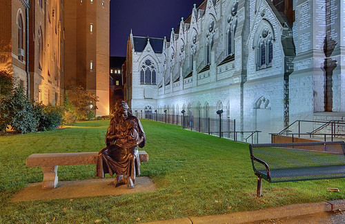 Statue of the Sacred Heart of Jesus, at Saint Louis University, in Saint Louis, Missouri, USA - view at night