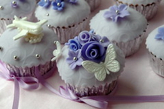 Wedding cupcakes for the bride and groom (creativecupcakes) Tags: roses white silver airplane purple blossoms lavender butterflies cupcake fondant dragees