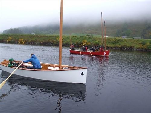 Goat Island skiff sailboat going through a Scottish Lock on a Loch