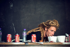 George (TGKW) Tags: boy portrait people food man water wall set dreadlocks pose hair studio table hongkong george video cola bottles expression watching coke cans coca bottled spacedout 6830 geddaheadz
