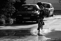 Summer Pleasures (A. Aleksandraviius) Tags: street city boy summer people urban bw white motion black water bike bicycle children cycling kid cycle winner lithuania d60 lietuva vanduo vaikas nikond60 dviratis aidimai