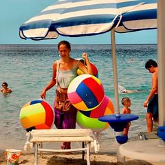 Balloons' Beach Pedlar Girl (Osvaldo_Zoom) Tags: summer italy beach girl beauty seaside balloon calabria immigrant pedalar beachproject rumenian