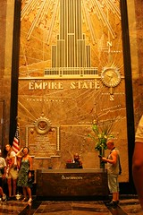 Empire State Building Reception Desk (stormdog42) Tags: newyorkcity newyork clock mural desk tourists lobby empirestatebuilding artdeco brass receptionist