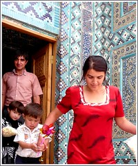Uzbekistan Family visiting the mausoleum Shah-i-Zinde (Ginas Pics) Tags: trip blue red woman white man cemetery kids walking tile dead dress god walk sandals turquoise muslim pray tomb group steps young mosque holy mausoleum tiles enjoy experience popcorn program offering silkroad traveling calligraphy brotherandsister uzbekistan samarkand sanctuary travelers mile allah steep muhammad active participate boygirl physical handrails happyfamily participants samarqand genghiskhan condition necropole youngmother youngfamily deserttown muslima brunett tamerlane motheroftwo unassisted familyscene   lumixaward escenafamiliar  shahizinde escenarfamiliar alsexanderthegreat uneventerrain culturaldifferences youngmuslimfamily