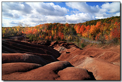 Cheltenham Badlands (Front Page) (Lisa-S) Tags: road blue autumn red sky ontario canada fall clouds colours lisas foliage badlands colourful allrightsreserved blend invited caledon cheltenhambadlands oct09 6659 platinumphoto theunforgettablepictures platinumheartaward getty2009 copyrightlisastokes getty20091208